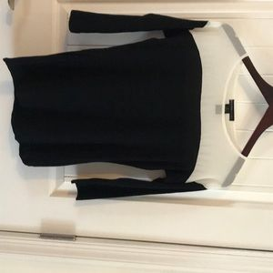 Black top with sheer white trim at top